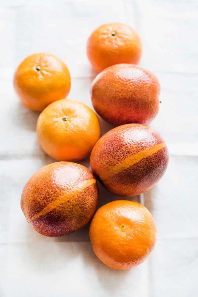 Красные апельсины и мандарины