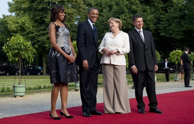 Ангела Меркель на встрече с четой Обама в брюках, которые не понравились Лагерфельду