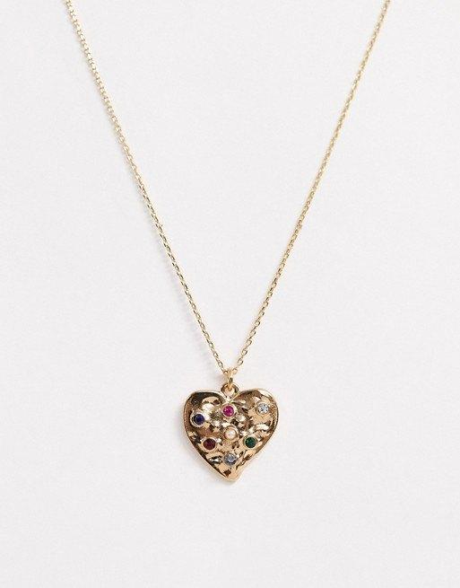 Золотистое ожерелье сподвеской-сердцем Accessorize, 590 руб.