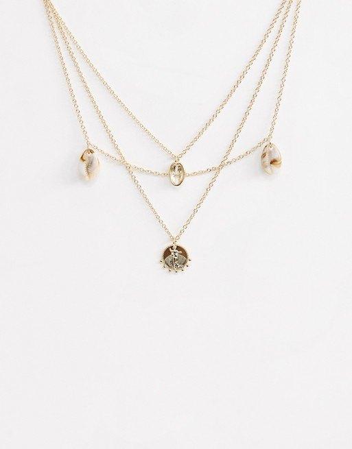 Ожерелье сракушками имонетами изполимера Liars & Lovers, 590 руб.