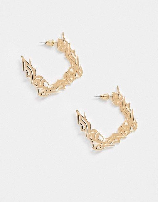 Золотистые серьги-кольца вготическом стиле, Asos Design, 690 руб.